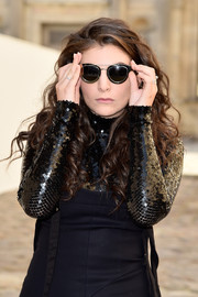 Lorde arrived for the Christian Dior fashion show sporting a pair of ultra-modern shades from the brand.