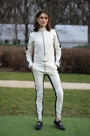 Olga Kurylenko went sporty in a quilted white leather jacket by Dior when she attended the label's Haute Couture show.