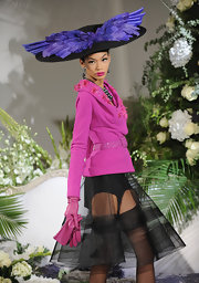 Chanel was vibrant on the Dior runway in a hot pink suit jacket with matching lips.