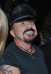 Peter finished off his all black look with a chain embellished leather biker hat.