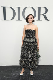 Olivia Cooke looked magnificent in a tiered, strapless lace dress by Dior during the brand's Spring 2019 show.