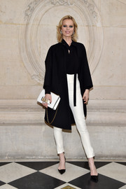Eva Herzigova teamed her coat with high-waisted white pants and a black blouse.