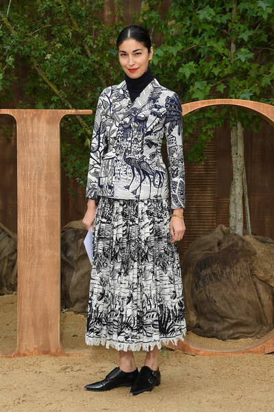 Caroline Issa attended the Dior Spring 2020 show wearing a graphic skirt suit from the brand.