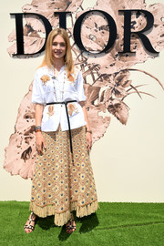 Natalia Vodianova donned a short-sleeve, embroidered button-down by Dior for the label's Haute Couture show.
