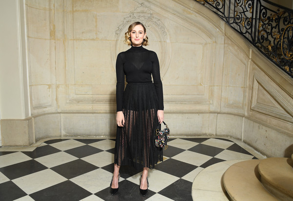 For a hint of color, Laura Carmichael accessorized with a printed Dior purse.