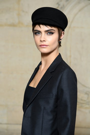 Cara Delevingne looked cute and cool wearing this black military cap at the Dior Fall 2018 show.