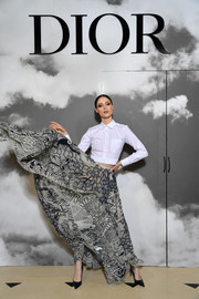 Coco Rocha dressed up her top with a printed maxi skirt.