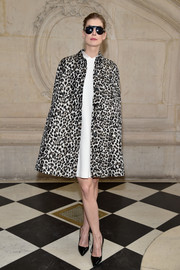 Rosamund Pike brought some vintage glamour to the Dior fashion show with this leopard-print cape.