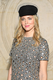 Chiara Ferragni attended the Dior Couture Spring 2018 show wearing a veiled black newsboy cap from the label.