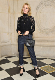 Eva Herzigova completed her casual-chic outfit with a pair of black ankle-tie pumps by Dior.