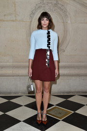 Gemma Arterton styled her outfit with a pair of brown T-strap pumps.