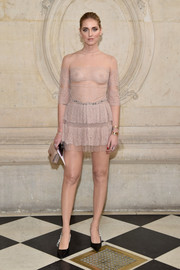 Chiara Ferragni dared to bare in a sheer nude mini dress by Dior during the label's fashion show.