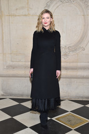 Kirsten Dunst looked very refined in a black Dior coat dress, which she balanced out with a flirty pleated skirt, during the label's Haute Couture show.