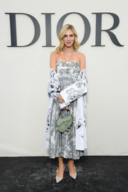 Chiara Ferragni chose a strapless print dress by Dior for the brand's Spring 2019 show.
