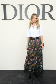 Melissa Benoist dressed up her top with a floral-embroidered maxi skirt.