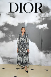 Olivia Palermo attended the Dior Couture Fall 2019 show wearing a graphic skirt suit from the brand.