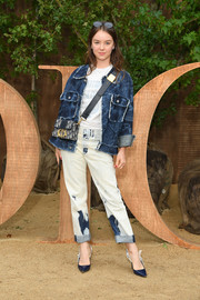 Alexandra of Hanover styled her outfit with a pair of navy and white slingback pumps.