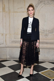 Chiara Ferragni layered a black blazer over a slogan tee, both by Dior, for the label's Haute Couture show.