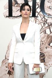 Gemma Arterton carried a white hand-strap clutch by Dior when she attended the label's Haute Couture show.