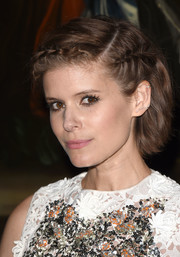 Kate Mara looked adorable with her partially braided short 'do at the Christian Dior Cruise show.