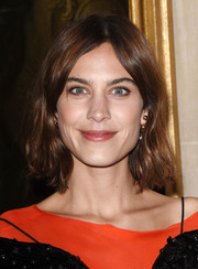 Alexa Chung attended the Christian Dior Cruise show wearing an unstyled short 'do.