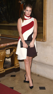 Kitty Spencer paired her frock with an elegant black satin clutch.
