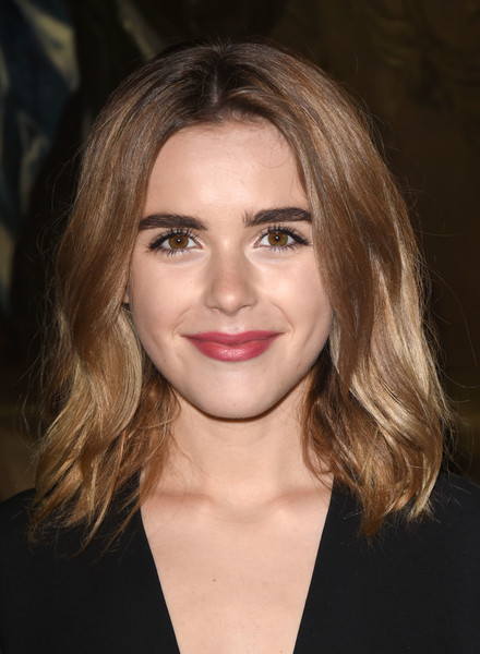 Kiernan Shipka attended the Christian Dior Cruise show wearing her hair in stylish shoulder-length waves.