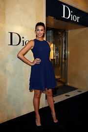 Megan Gale cut a feminine silhouette in a blue cocktail dress with a flared skirt during the opening of the Christian Dior store in Sydney.
