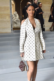 Rihanna paired her elegant dress with a patterned purse, also by Dior.