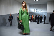 Miroslava Duma brightened up the Dior tunnel with this green leather coat during Paris Fashion Week.