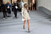 Anna dello Russo headed to the Dior fashion show wearing a pair of sexy black lace-up heels.