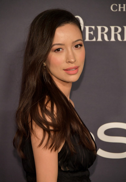Christian Serratos Long Side Part [hair,face,hairstyle,long hair,beauty,eyebrow,chin,brown hair,layered hair,premiere,arrivals,christian serratos,the getty center,los angeles,california,3rd annual instyle awards]