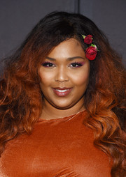 Lizzo rocked a long teased wavy 'do at the Christian Siriano fashion show.