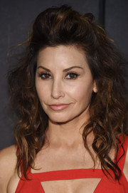 Gina Gershon looked fabulous with her teased, half-up curls at the Christian Siriano fashion show.