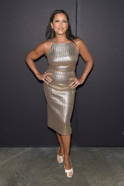 Vanessa Williams worked her figure in a fitted gold cocktail dress at the Christian Siriano fashion show.