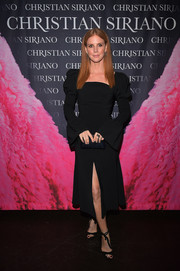 Sarah Rafferty chose a little black dress with puffed sleeves and a high front slit for the 'Dresses to Dream About' book launch.