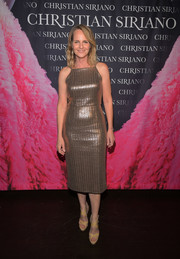 Helen Hunt shimmered in a fitted gold frock at the 'Dresses to Dream About' book launch.