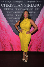 Niecy Nash went for a shape-flaunting cable knit-print frock by Christian Siriano when she attended the 'Dresses to Dream About' book launch.
