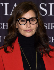 Gina Gershon looked lovely with her face-framing curls at the 'Dresses to Dream About' book release.