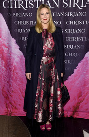Drew Barrymore finished off her dress with an inky blue coat.