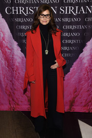 Gina Gershon looked impeccable in a red trenchcoat by Christian Siriano at the 'Dresses to Dream About' book release.