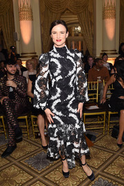 Juliette Lewis donned a black-and-white lace dress by Christian Siriano for the label's fashion show.