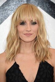 Nastia Liukin was summer-glam with her messy blonde waves and eye-skimming bangs at the Christian Siriano fashion show.