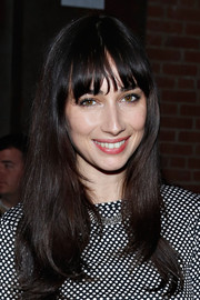 Rebecca Dayan styled her hair with wavy ends and her usual blunt bangs for the Christian Siriano fashion show.
