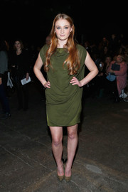 Sophie Turner attended the Christian Siriano fashion show looking fab in a draped green cocktail dress.