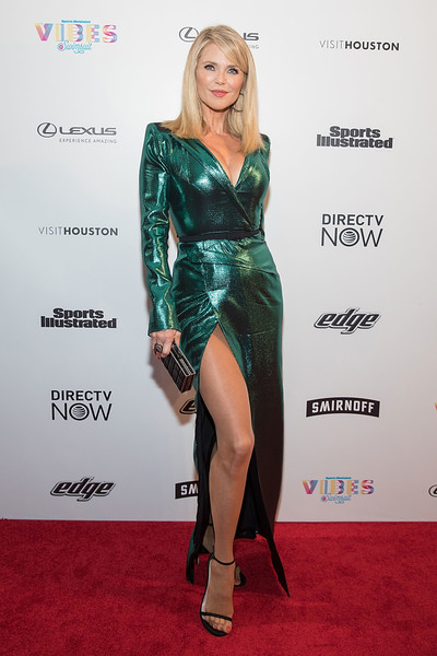 Christie Brinkley Strappy Sandals [si swimsuit,fashion model,footwear,flooring,leg,shoulder,thigh,carpet,latex clothing,joint,human leg,model,swimsuit 2017,christie brinkley,vibes,houston,texas,sports illustrated,swimsuit 2017 launch festival,launch festival]