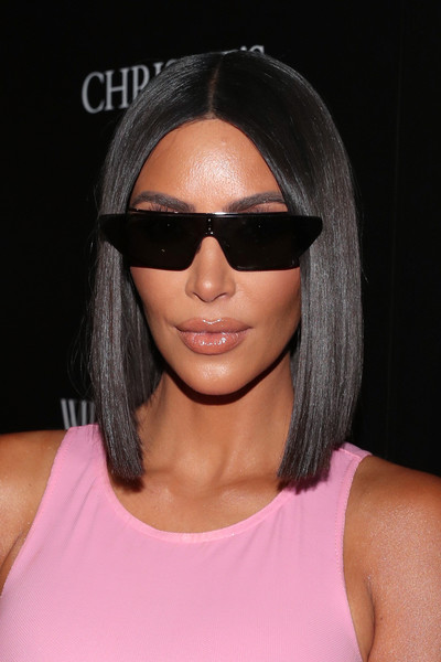 Kim Kardashian amped up the modern vibe with a pair of blade sunglasses.