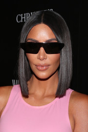 Kim Kardashian accentuated her pout with a swipe of gloss.