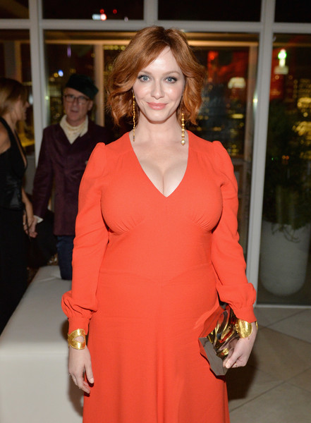 Christina Hendricks Cuff Bracelet [clothing,red,orange,fashion,fashion model,dress,cocktail dress,event,neck,brown hair,kost,american woman,christina hendricks,american woman premiere party,toronto,canada,premiere party]