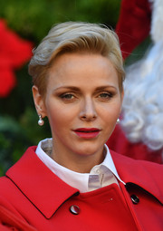 Charlene Wittstock wore her hair in a cool fauxhawk at the Christmas gifts distribution at Monaco Palace.